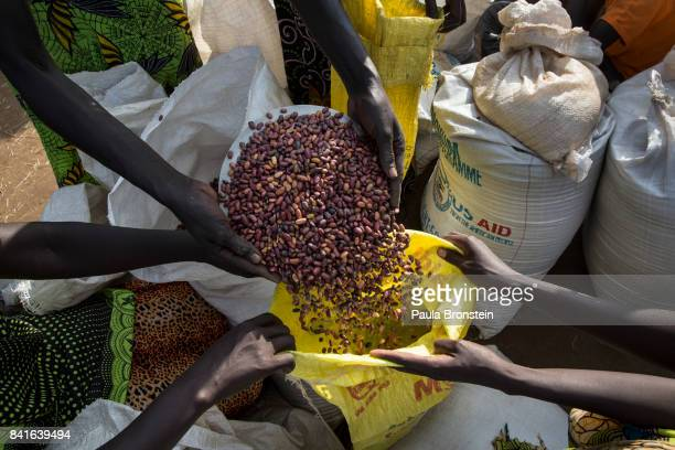 At a refugee camp WFP delivers monthly food aid to Sudanese refugees The Onward Struggle A refugee crisis in Uganda deepens as South Sudanese...