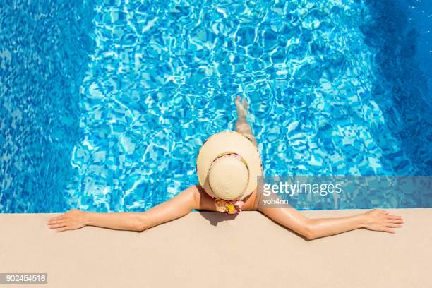 At a resort swimming pool