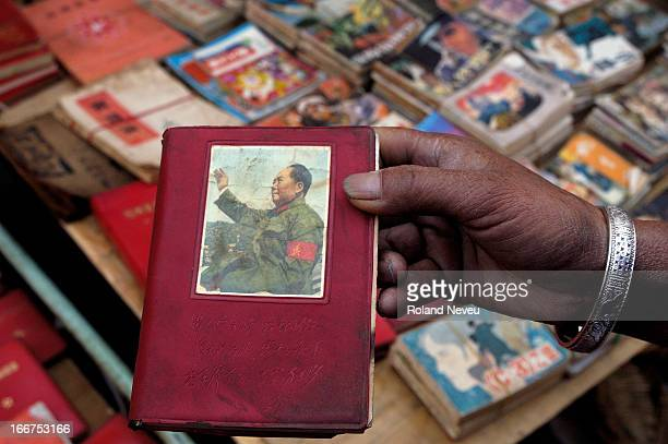 At a souvenir market in Dali a historic city in Yunnan Western China used small Red Book of Mao Zedong are on sale to mostly Chinese tourists