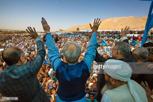 At a speech led by Dr Abdullah Abdhullah as part of his presidential campaign waves at the crowd who have come to listen to him Dr Abdullah Abdullah...
