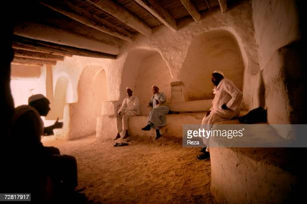 At a street intersection men meet in a square to have a conversation April 2000 in Ghadames Libya
