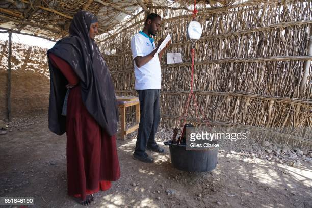At a UNICEF medical center in Wajid central Somalia a mother watches as her baby is weighed According to a United Nations February 2017 report famine...