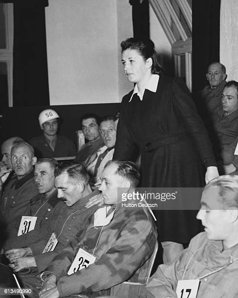 At a war crimes trial Reba Levy a Jewish Lithuanian exprisoner of Dachau concentration camp identifies Johann Victor Kirach as the perpetrator of...