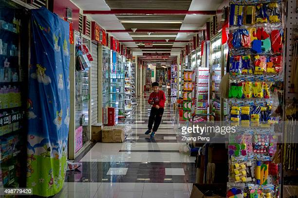 At a weekend children play in the aisle of stalls whose parents are the suppliers of Yiwu China Commodity City China Commodity City is a large...