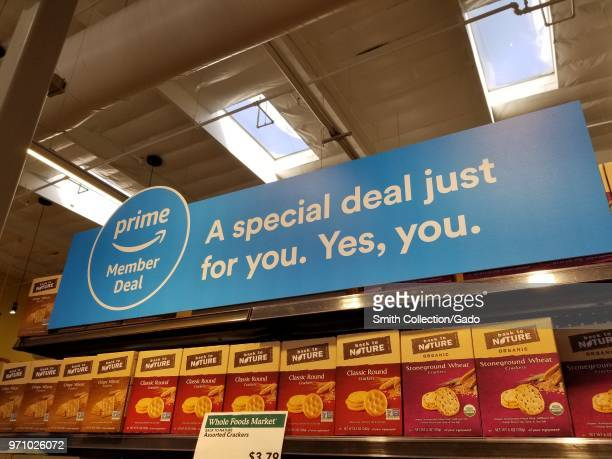 At a Whole Foods Market grocery store in San Ramon California signage advertises new discounts for members of the Amazon Prime service from Amazon...