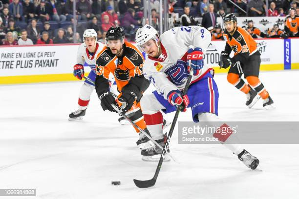 at Alexandre Alain of the Laval Rocket driving to the net with the puck while TJ Brennan of the Lehigh Valley Phantoms follows closely Place Bell on...