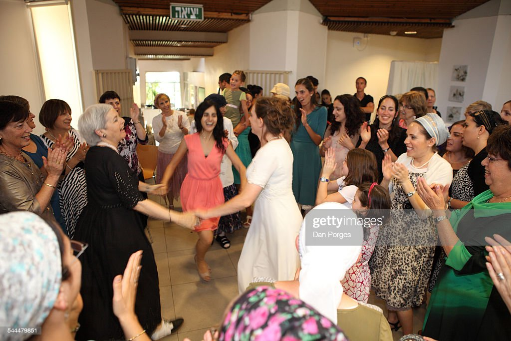 At An Orthodox Jewish Wedding Guests Surround The Bride In White Holds