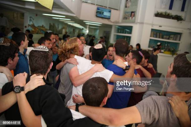 At an unidentified yeshiva male high school students sing and dance arminarm as they celebrate Rosh Chodesh Nisan Modi'inMaccabimRe'ut Israel March...