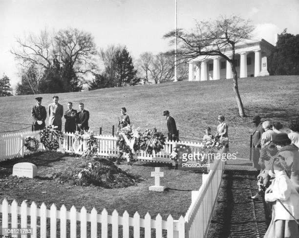 At Arlington National Cemetary mourners walk past the grave of assassinated President John F Kennedy Arlington Virginia March 10 1964 Also within the...