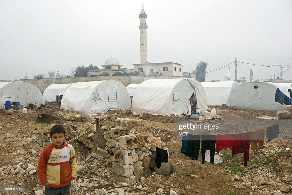 At Azaz camp for displaced Syrians, more than 12,000 are housed in the 1000 tents, but there's a waiting list for 1400 more tents, and in the meantime families must live in nearby villages, which are subject to government bombing raids. The tents are heated with a simple coal stove, but the gases, which have no room to escape in the close quarters, cause respiratory ailments.