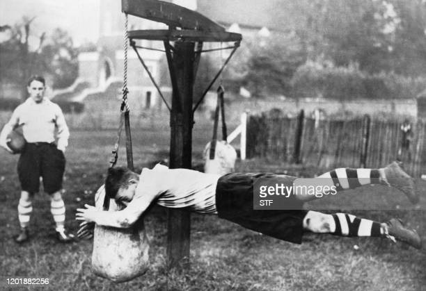 At Bedford School in London well known for its famous Rugby team these english students practise tackle with strange machines during a rugby training...