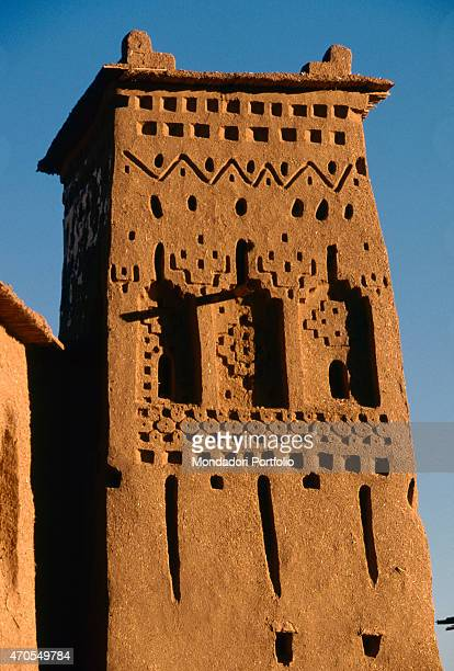 'At Benhaddou 17th century brickwork Morocco At Benhaddou Whole artwork view A tower in the fortified city of At Benhaddou its upper section is...
