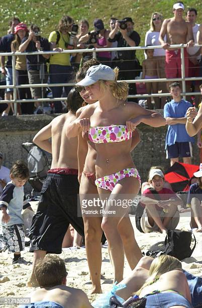 SPEARS at Bondi Beach enjoying the sun BRITNEY is in Australia to promote her latest single Slave 4 You BRITNEY is wearing a Ken Done designed...