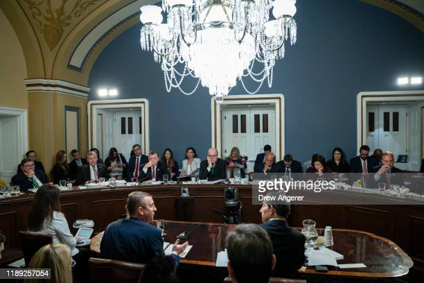 At bottom from L House Judiciary Committee ranking member Rep Doug Collins and Rep Jamie Raskin attend a House Rules Committee hearing concerning the...