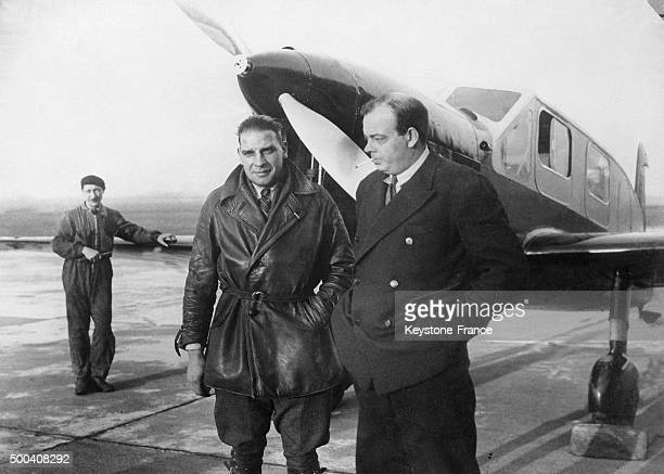 At Bourget the pilot Antoine de SaintExupery and his engineer Andre Prevot posing in front of the Caudron Simoun plane before the departure for a...