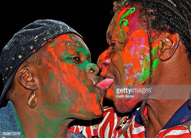 At Brooklyn J'Ouvert Labor Day Carnival Two People With Their Faces Brightly Painted Are Being Festive and Celebrating Their Culture As They Tongue...