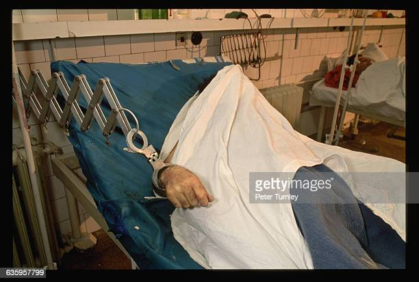 At Bucharest's Emergency Hospital a sheet covers the face of a dead secret police officer from Nicolae Ceausescu's infamous Securitate organization...