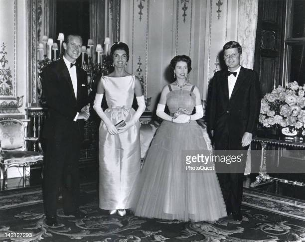 At Buckingham Palace during a banquest held in his honor American President John F Kennedy and his wife First Lady Jacqueline Kennedy pose with Queen...
