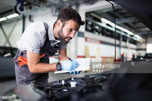 at car service - garage stock pictures, royalty-free photos & images