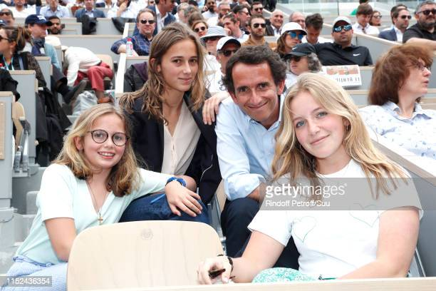 CEO at Carrefour Group Alexandre Bompard with his daughters Alma Bompard Juliette Bompard and Romane Bompard attend the 2019 French Tennis Open Day...