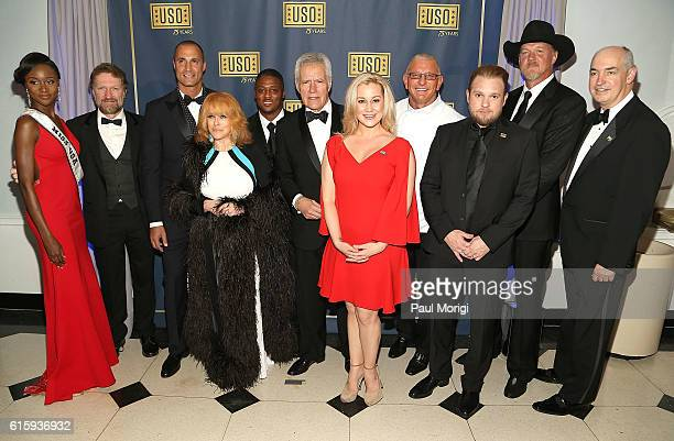 At center 'Jeopardy' host Alex Trebek makes country music star Kellie Pickler laugh during a group photo with Miss USA Deshauna Barber Singer Craig...