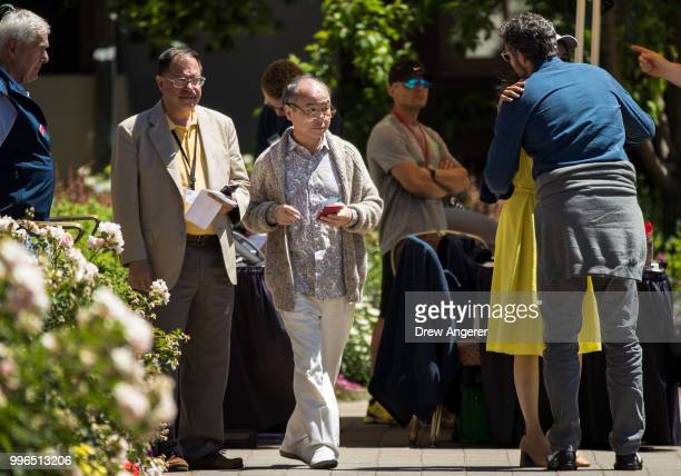 At center Masayoshi Son chief executive officer of SoftBank attends the annual Allen Company Sun Valley Conference July 11 2018 in Sun Valley Idaho...