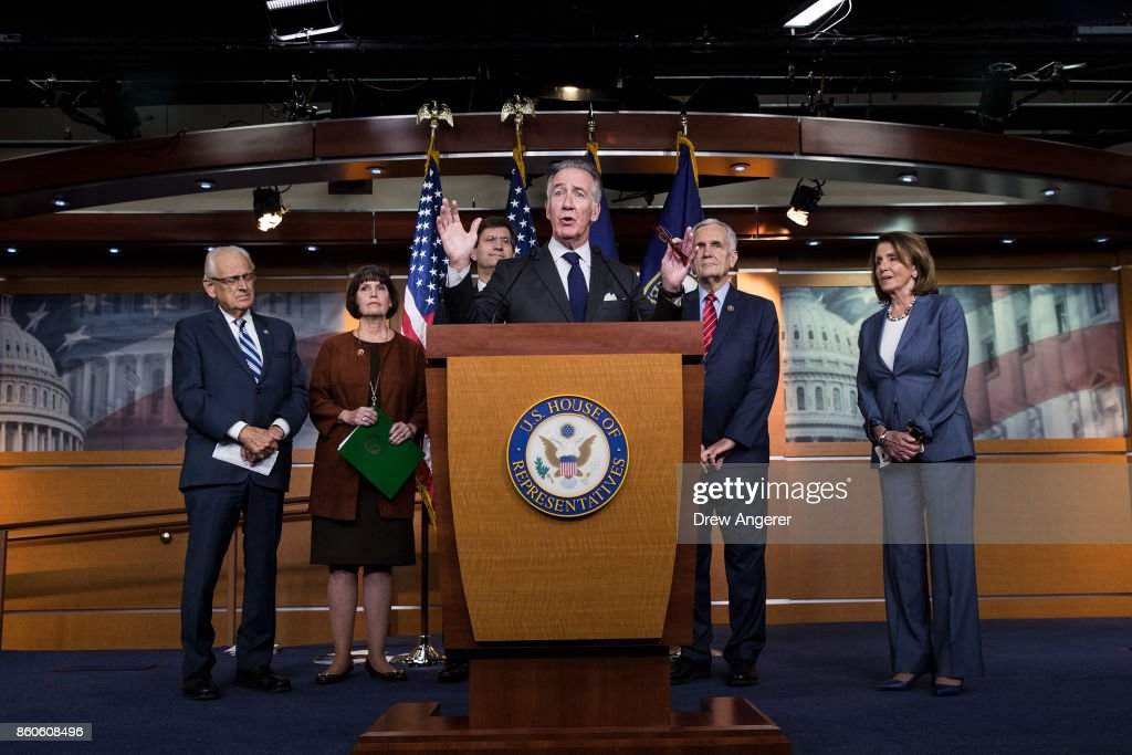 At center, ranking member of the House Ways and Means Committee Rep. Richard Neal (D-MA) speaks during a news conference on Republican plans to end the state and local tax deduction, on Capitol Hill, October 12, 2017 in Washington, DC. Also pictured (L to R), Rep. Bill Pascrell (D-NJ), Rep. Betty McCollum (D-MN), Rep. Brad Schneider (D-IL), Rep. Lloyd Doggett (D-TX) and House Minority Leader Nancy Pelosi (D-CA). The Democrats called on Congressional Republicans to hold open and public hearings on their plans for tax reform.