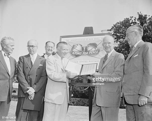 """At ceremonies on the south lawn of the White House today, marking the issuance of a new three-cents """"Atoms for Peace"""" commemorative stamp, Postmaster..."""