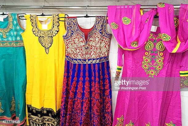 DELHI INDIA 2015 At Chandni Chowk a centuriesold market in Old Delhi shoppers can select from an array of colorful dresses including some made in...