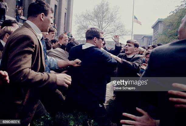 At Columbia University a student protest turns physical as young men one in a clerical collar push one another New York New York 1968 The protest was...