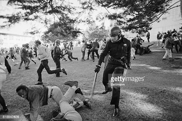 At Cross Purposes San Francisco Policemen swing clubs and dissident students try to scramble out of reach here December 3rd as some 300 policemen...