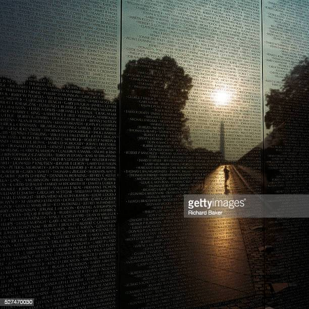 At dawn a week after the September 11th attacks in New York and in Washington DC we see the haunted figures of war veterans looking up at the names...