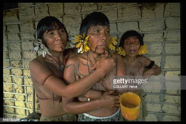 At dawn after singing and bereavement dances the women eat the ash of their dead mixed with banana mash This is the final ritual in the Rehao...