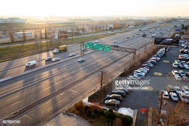 At dawn cars drive down the US 9 highway past Newark Liberty International Airport Newark New Jersey December 21 2016
