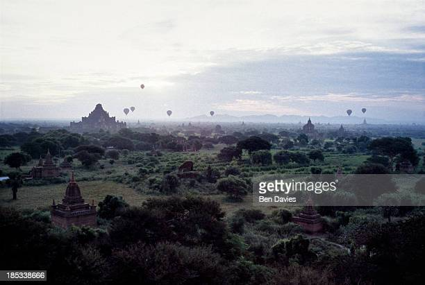 At dawn hot air balloons drift over the ancient temples of Bagan as viewed from the Shwesandaw Temple In all there are more than 2000 temples and...