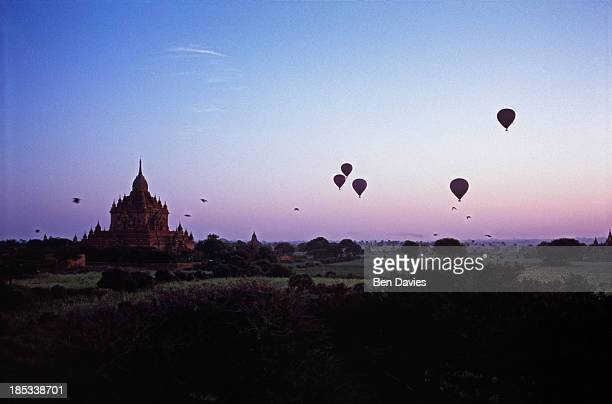 At dawn hot air balloons drift over the ancient temples of Bagan one of the most important tourist attractions in Myanmar In all there are more than...