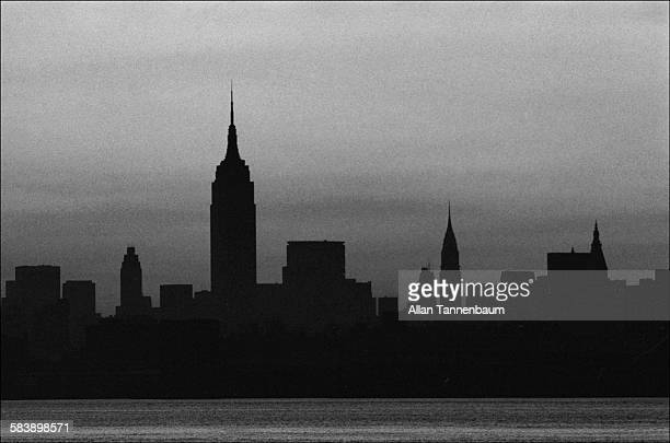 At dawn the Manhattan skyline shows no lights due to a power blackout New York New York July 14 1977 The photo was taken from Jersey City New Jersey
