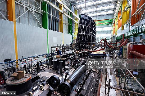 at DCNS company the production site of the new french submarine the Barracudain Cherbourg on April 29 2016 A boilermaker informant screws a necklace...