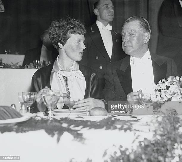 At Dinner in Honor of Hindenburg's Crew Mrs Amelia Earhart Putnam and Dr Alexander V Dye snapped at a dinner tender by the Board of Trade for...