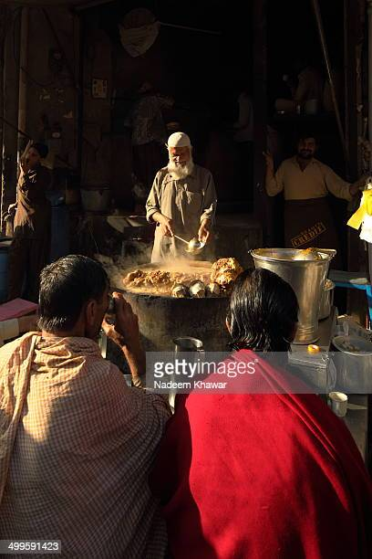 """At downtown Lahore a traditional breakfast seller is putting the hot soup made from the goat's head and feet called """"SiRi Paey"""". It is the very..."""