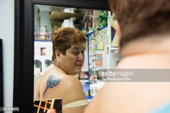 7e1aa81621af7 At Dragon Moon Tattoo Studio Inc. in Glen Burnie, MD and tattoo... News  Photo - Getty Images