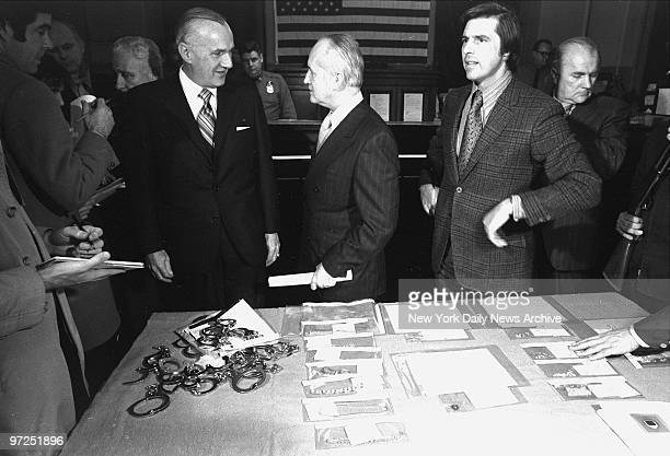 At E 67th St station house FBI New York director John Malone Police Commissioner Murphy and Robert Daley deputy commissioner for police public...