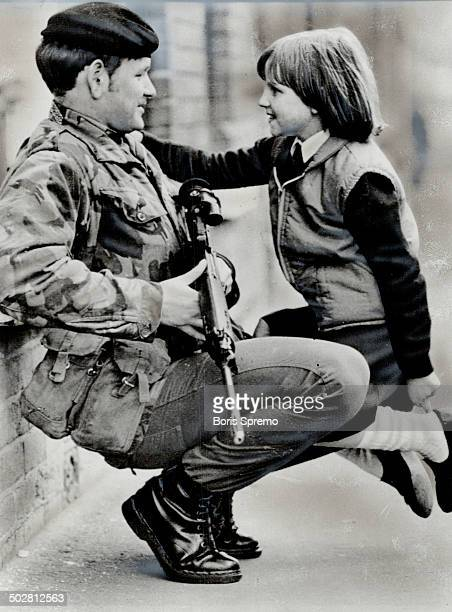 At ease soldier Northern Ireland's unrest seems miles away as little Lisa Darrah 9 climbs on a Briiths soldier's knee to have a friendly word The...