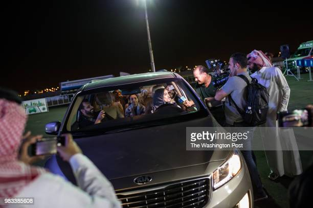 At exactly midnight on June 24 the day the ban on women driving in Saudi is lifted a woman is interviewed by local and foreign journalists as she is...