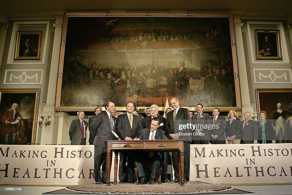 Mass. Gov. Mitt Romney Signs Health Care Bill : News Photo