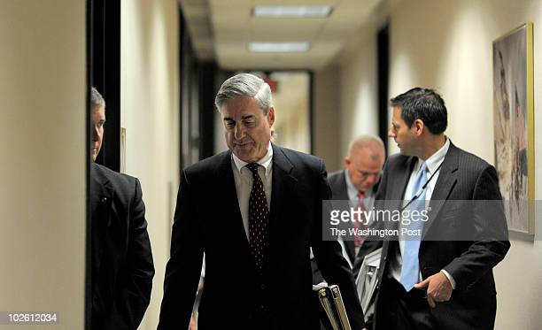 At FBI headquarters FBI Director Robert Mueller begins his long day at at 7 am with a security briefing and several meetings with staff Friday June 4...