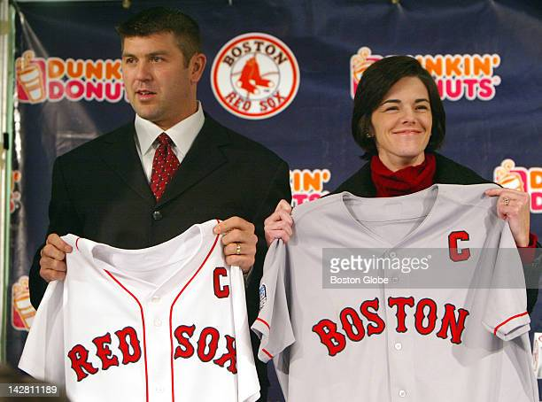 At Fenway Park Red Sox catcher Jason Varitek holds his game jerseys with his wife Karen as he was given the designation as team captain at a press...
