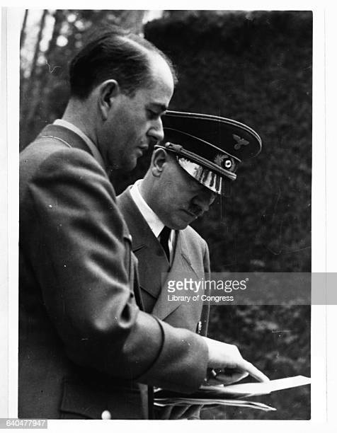 At FHQ Wolfsschanze Adolf Hitler looks over some papers with architect and armaments minister Albert Speer
