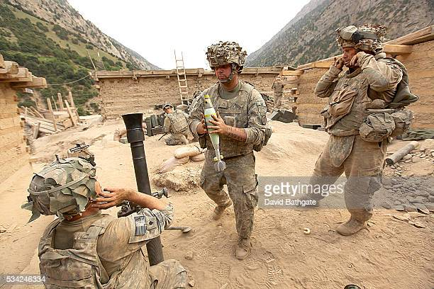 At Firebase Lindstrom Charlie Company the US Army's 10th Mountain Division prepares to fire mortars on Taliban mountain side positions near the...