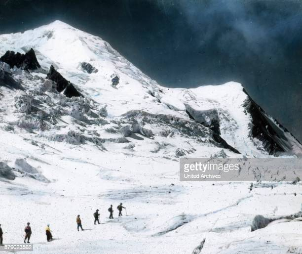 At first it is only slightly rising above the glacier of time which is crisscrossed by numerous streams and covered with rock debris In some places...
